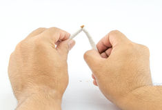Close-up Of Human Hands Breaking The Cigarette Stock Image