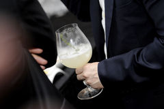 Close-up of human hands with cocktail Stock Image