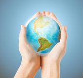 Close up of human hands with earth globe. People, geography, population and peace concept - close up of human hands with earth globe showing american continent royalty free stock photo