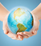 Close up of human hands with earth globe. People, geography, population and peace concept - close up of human hands with earth globe showing american continent royalty free stock images