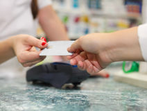 Close up of human hands holding credit card Stock Photography