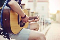 Close up of human hands playin guitar Royalty Free Stock Photos