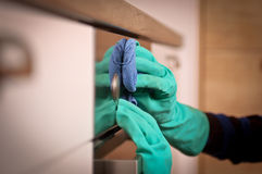 Cleaning the oven. Close-up of human hands polishing the oven Royalty Free Stock Image