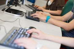 Typing process in the classroom Stock Photos