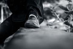 Close up of human legs wearing black shoes. Close up of human legs wearing black shoes and black jeans Stock Photo