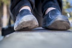 Close up of human legs wearing black shoes. Close up of human legs wearing black shoes and black jeans Royalty Free Stock Images