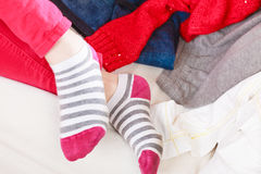 Close up of human woman feet in striped socks. Close up of human woman feet in colorful striped socks Stock Photography