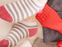 Close up of human woman feet in striped socks. Close up of human woman feet in colorful striped socks. Instagram filter Royalty Free Stock Image