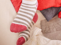 Close up of human woman feet in striped socks. Close up of human woman feet in colorful striped socks. Instagram filter Royalty Free Stock Photography