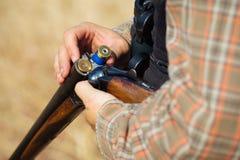 Close-up of a hunter loading his shotgun Royalty Free Stock Image