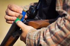 Close-up of a hunter loading his shotgun. Close-up picture of a hunter loading his shotgun Royalty Free Stock Photography