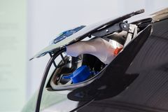 Close up of Hybrid car electric charger stock image