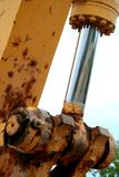 Close-up of a hydraulic piston. On a back hoe stock images