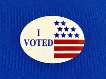 `I voted` sticker on blue fabric royalty free stock photography
