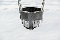 Close Up of a Ice Covered Playground Swing Seat Royalty Free Stock Photo
