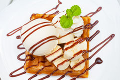 Close up Ice cream waffle banana with chocolate sauce and mint l stock images
