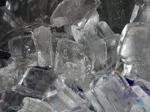 Close-up of ice cubes. Piled into a metal cooler Stock Photos
