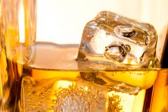 Close-up of ice cubes in the whiskey Stock Photo
