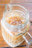 Close up iced coffee latte in glass pitcher Stock Images