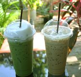 Iced green tea and iced coffee. Close up iced green tea and iced coffee royalty free stock images