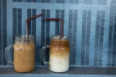 Iced latte and iced mocha in glasses. Close up of iced latte and iced mocha in glasses Royalty Free Stock Images