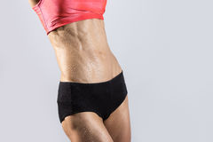 Close-up of ideal sexy sweating abs of beautiful athletic woman Stock Photo