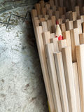 Close up of identical graphite pencils and one different red  cr Royalty Free Stock Photo