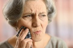 Close-up of ill elderly woman Royalty Free Stock Images
