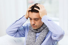 Close up of ill man with flu and headache at home Royalty Free Stock Image