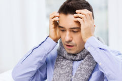 Close up of ill man with flu and headache at home Stock Images