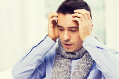 Close up of ill man with flu and headache at home Royalty Free Stock Images