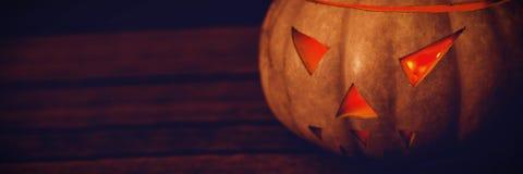 Close up of illuminated jack o lantern on table during Halloween Stock Photography