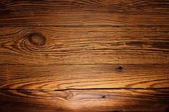 Illuminated wooded panel as a background image royalty free stock photo