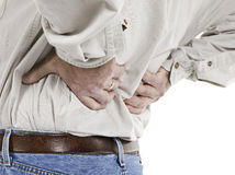 Close up image of aged man having back pain Royalty Free Stock Images