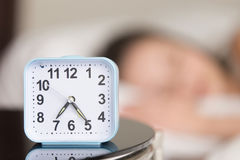 Close up image of alarm clock on bedside table Royalty Free Stock Photo