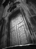 Close-up image of ancient doors. Black and white stock photo