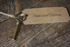 Antique Metal House Keys and Brown Label. A close up image of an antique brass house key with brown label Royalty Free Stock Photos