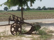 Close up image of antique farm machinery stock image