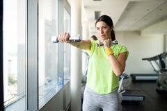 Close up image of attractive fit woman in gym royalty free stock photography