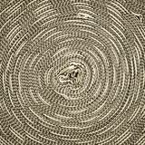 Close-up surface rope roll round. Close-up image Background surface of an ancient threaded knitting rope, which is a barricade at the scene Royalty Free Stock Image