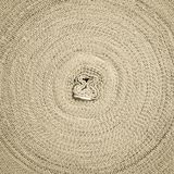 Close-up surface rope roll round. Close-up image Background surface of an ancient threaded knitting rope, which is a barricade at the scene Royalty Free Stock Photo