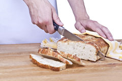 A baker cutting the bread Stock Image