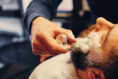 Close up image of barber shaving stock photography