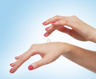 Close-up image of beautiful female hands and cream Stock Images