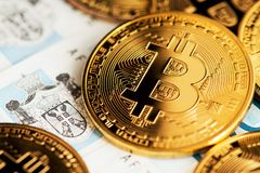 Close up image of bitcoin cryptocurrency with Serbian Dinar banknotes. Background with cryptocurrency bitcoin on Serbian Dinar. stock photography