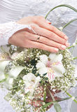Close-up image of a bride holding beautiful flowers Stock Image