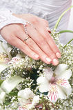 Close-up image of a bride holding beautiful flowers Stock Photo