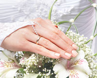 Close-up image of a bride holding beautiful flowers Royalty Free Stock Photography