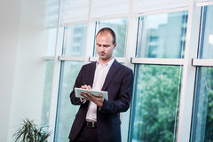 Close up image of business man holding a digital tablet,Portrait Stock Photo
