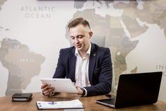 Close up image of business man holding a digital tablet,Portrait Stock Images